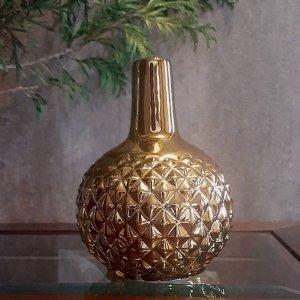 Jarrón dorado combinable con decoraciones actuales rústicas y modernas