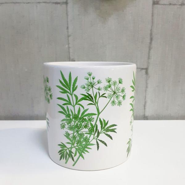 Maceta con ilustraciones vegetales verdes