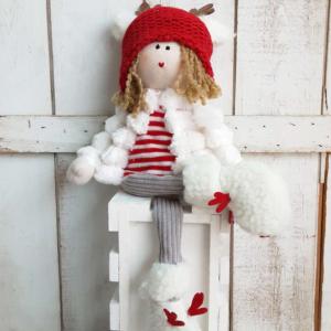 Muñeca de Navidad muy bonita y suave, en colores rojo y blanco.