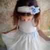Niña con vestido ceremonia y complementos en azul