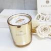 Vela elegante en envase golden para decoración con estilo